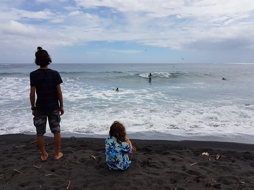 The boys watching surfers
