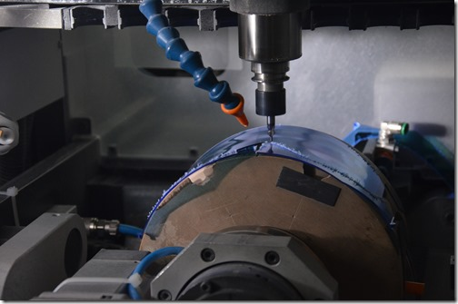 A lens being milled