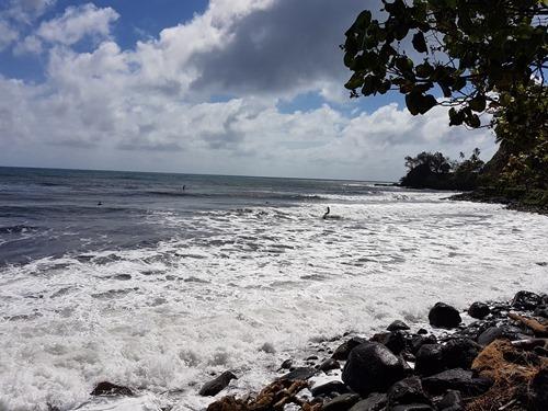 Surfers in Tahiti