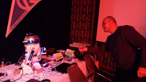 Serge from Robosphere using the Millenium Falcon to turn off R2-D2