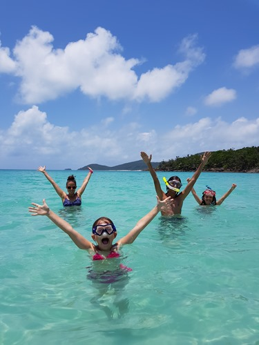 The family in the water at Whitehaven Beach