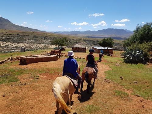 Riding through a village