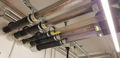 Black, grey and yellow water pipes