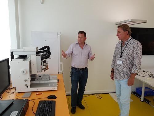 Denis showing Peter a bio-printer