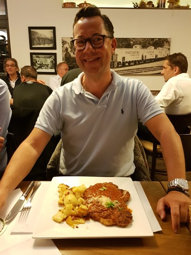Sander trying schnitzel with Bolognaise sauce